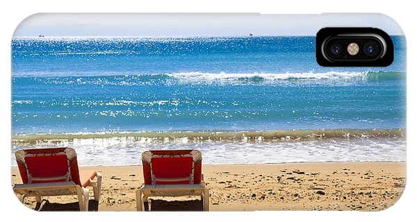Two Empty Sun Loungers On Beach By Sea IPhone Case