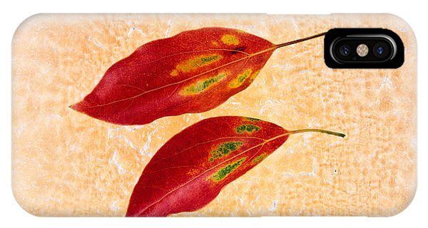Mottled iPhone Case - Two Red Leaves On Pink Background by Panoramic Images