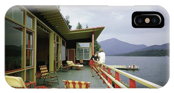 Two Women On The Deck Of A House On A Lake IPhone Case