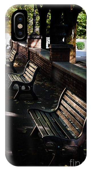 unoccupied park benches in the shade of trees in Palestrina IPhone Case