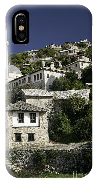 views of pocitelj in Bosnia Hercegovina with minaret bridge and river IPhone Case