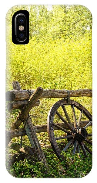 Wagon Wheel iPhone Case - Wheel On Fence by Carlos Caetano