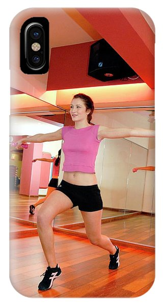 Woman Exercising In A Gym Phone Case by Aj Photo/science Photo Library
