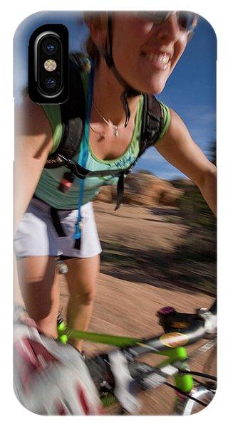 Woman Mountain Biking, Moab, Utah IPhone Case