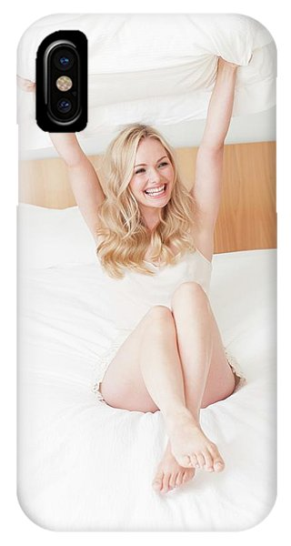 Woman Sitting On Bed Holding Pillow Phone Case by Ian Hooton