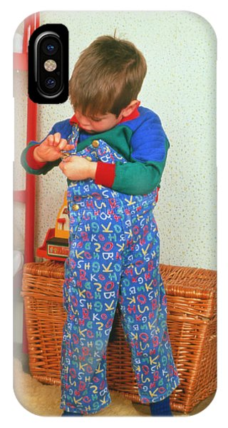 Dressing iPhone Case - Young Child Adjusting His Dungarees by Ron Sutherland/science Photo Library