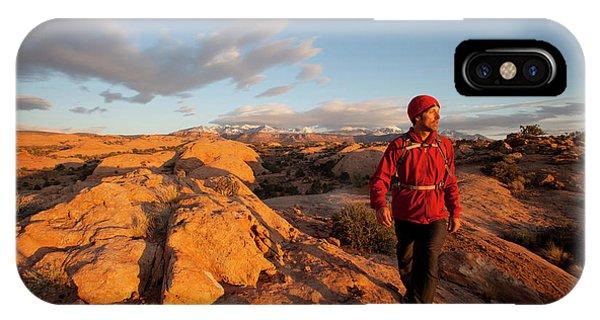 Slickrock iPhone Case - Young Man Hiking On Slickrock by Justin Bailie