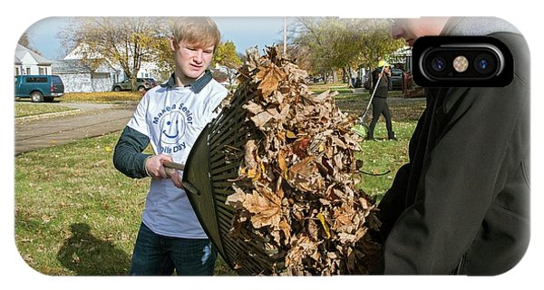 Altruism iPhone Case - Young Volunteers Raking Leaves by Jim West