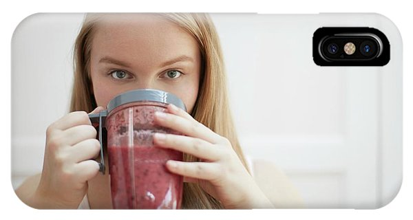 Smoothie iPhone Case - Young Woman Drinking Homemade Smoothie by Science Photo Library