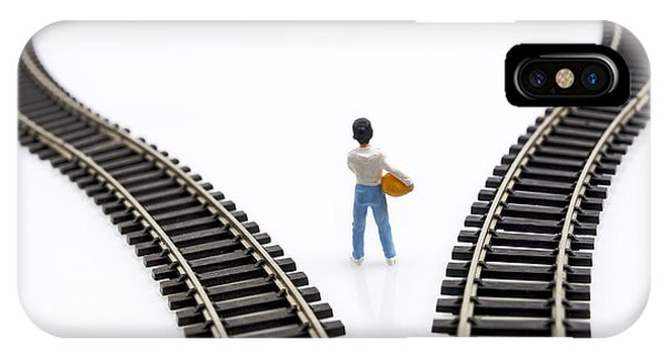 Cutout iPhone Case - Figurine Between Two Tracks Leading Into Different Directions Symbolic Image For Making Decisions. by Bernard Jaubert