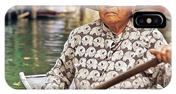 Famous Artist iPhone Case - An Elderly Lady Rowing Along The by Tommy Tjahjono