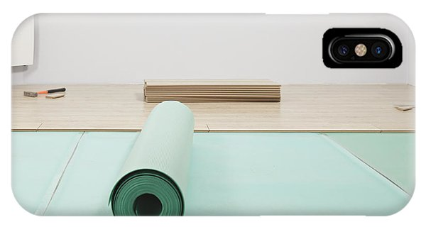Laying A Floor. A Roll Of Underlay Or Phone Case by Magomed Magomedagaev