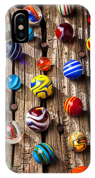 Novelty iPhone Case - Marbles On Wooden Board by Garry Gay
