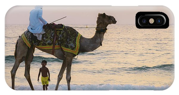 Little Boy Stares In Amazement At A Camel Riding On Marina Beach In Dubai, United Arab Emirates -  IPhone Case