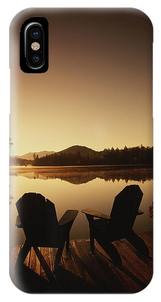 A Pair Of Adirondack Chairs On A Dock IPhone Case