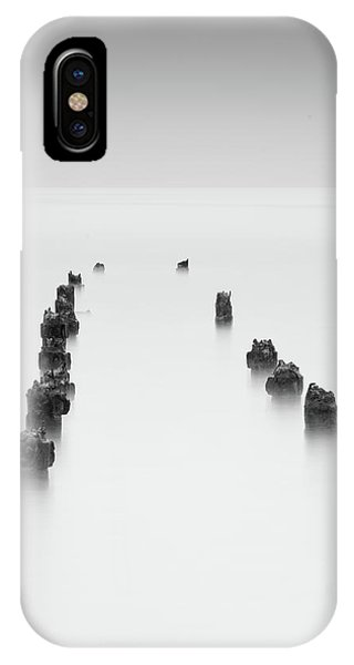 IPhone Case featuring the photograph Damaged Wooden Poles Of An Old Pier In The Ocean. by Michalakis Ppalis