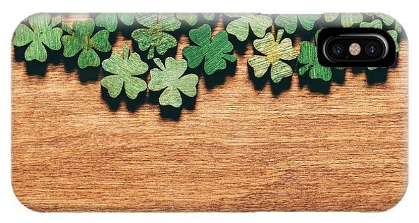 St. Patricks Day iPhone Case - Wooden Green Shamrocks Laying On The Wooden Floor. by Michal Bednarek