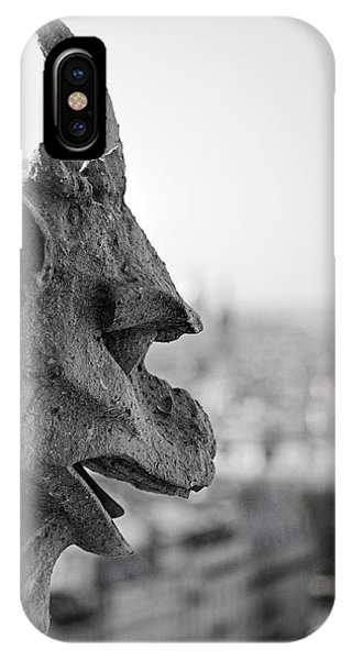 IPhone Case featuring the photograph Gargoyle Guarding The Notre Dame Basilica In Paris by Pierre Leclerc Photography