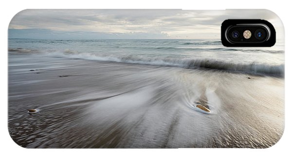 IPhone Case featuring the photograph Pebbles In The Beach And Flowing Sea Water by Michalakis Ppalis