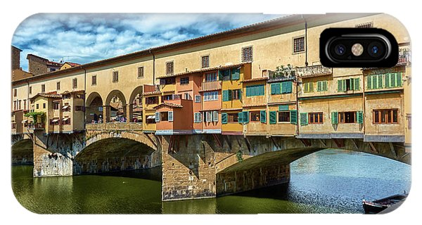 Ponte Vecchio On The Arno River Under A Blue Sky In Florence, Italy IPhone Case