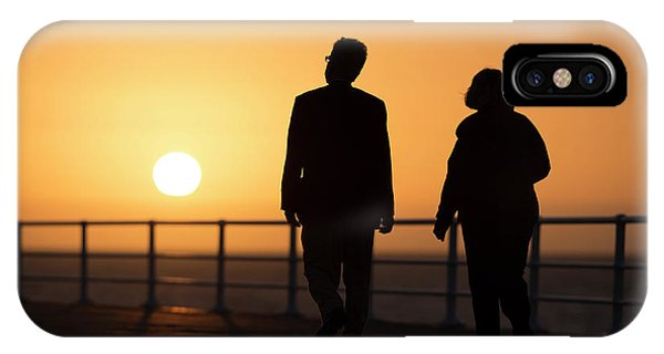 A Couple In Silhouette Walking Into The Sunset IPhone Case