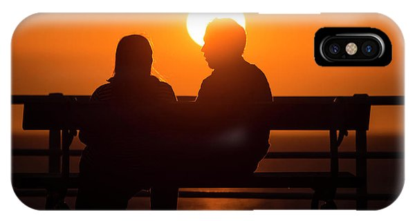 A Couple Sitting At Sunset IPhone Case