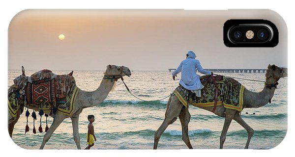 A Little Boy Stares In Amazement At A Camel Riding On Marina Beach In Dubai, United Arab Emirates IPhone Case