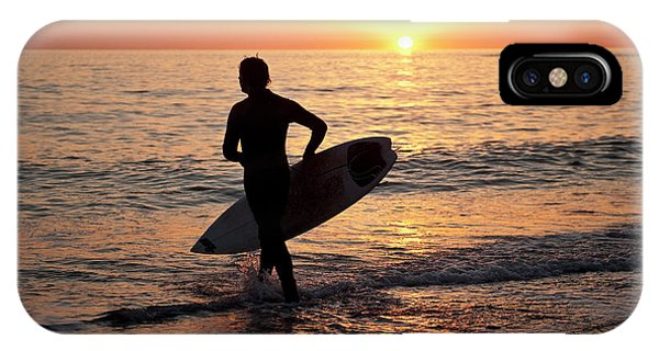 A Young Man Surfing At Sunset Off Aberystwyth Beach, Wales Uk IPhone Case