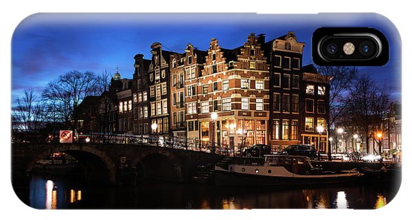 IPhone Case featuring the photograph Amsterdam Canal Houses Illuminated At Dusk by IPics Photography