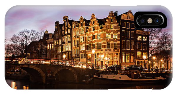 IPhone Case featuring the photograph Amsterdam Canal Houses With Reflection At Dusk by IPics Photography