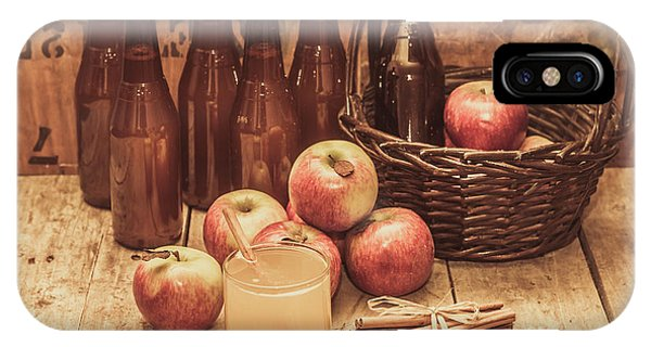 Closeup iPhone Case - Apples Cider By Wicker Basket On Wooden Table by Jorgo Photography - Wall Art Gallery
