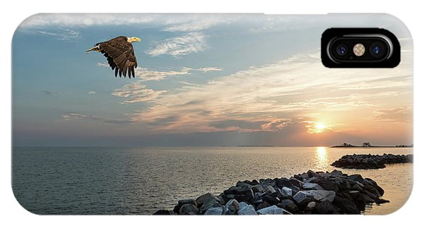 Bald Eagle Flying Over A Jetty At Sunset IPhone Case