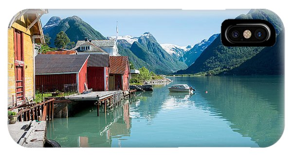 IPhone Case featuring the photograph Boathouse With Mountains And Reflection In The Fjord In Norway by IPics Photography