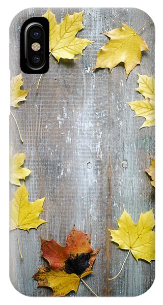 Circle Of Autumn Leaves On Weathered Wood IPhone Case