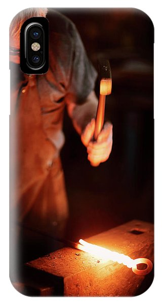 Anvil iPhone Case - Close-up Of  Blacksmith Forging Hot Iron by Johan Swanepoel