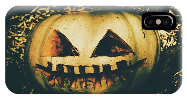 Yard iPhone Case - Closeup Of Halloween Pumpkin With Scary Face by Jorgo Photography - Wall Art Gallery
