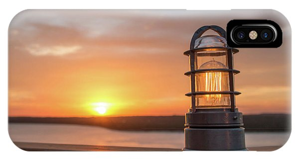 Closeup Of Light With Sunset In The Background IPhone Case