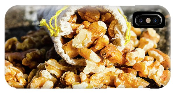 Nature Still Life iPhone Case - Closeup Of Walnuts Spilling From Small Bag by Jorgo Photography - Wall Art Gallery