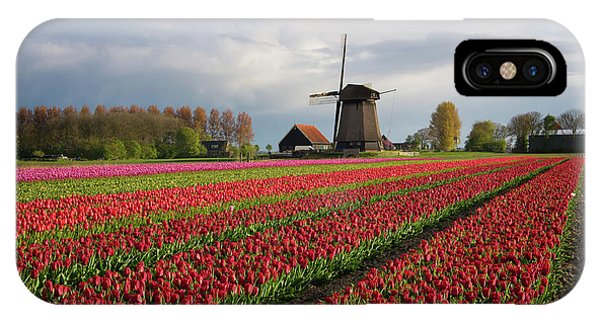 IPhone Case featuring the photograph Colorful Rows Of Tulips In Front Of A Windmill by IPics Photography