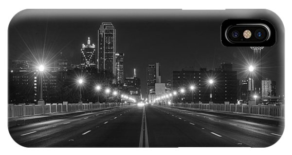 IPhone Case featuring the photograph Crossing The Bridge To Downtown Dallas At Night In Black And White by Todd Aaron