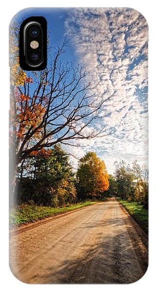 IPhone Case featuring the photograph Dirt Road And Sky In Fall by Lars Lentz