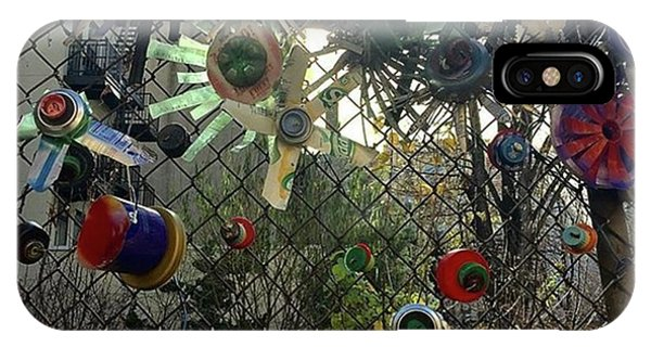 Fence Decorations Surrounding A Phone Case by Gina Callaghan