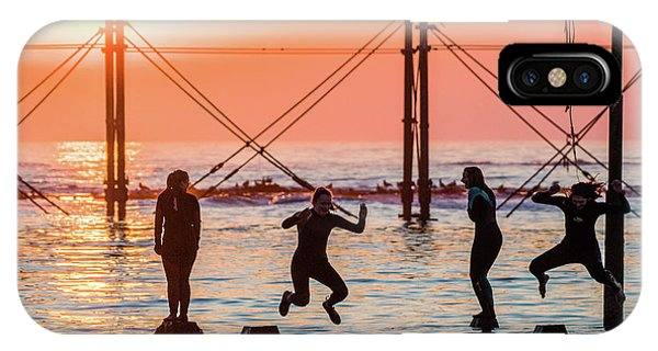 Four Girls Jumping Into The Sea At Sunset IPhone Case