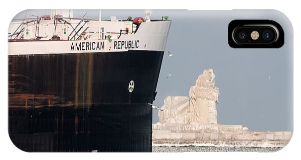 Great Lakes Ship Passing A Frozen Cleveland Lighthouse IPhone Case
