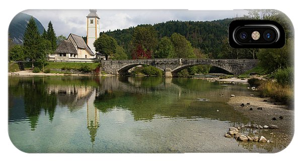 IPhone Case featuring the photograph Lake Bohinj With Church In Slovenia by IPics Photography