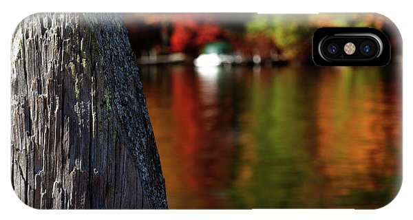 Lake Winnepesaukee Dock With Foliage In The Distance IPhone Case