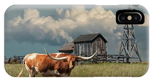 Longhorn Steer In A Prairie Pasture By Windmill And Old Gray Wooden Barn IPhone Case