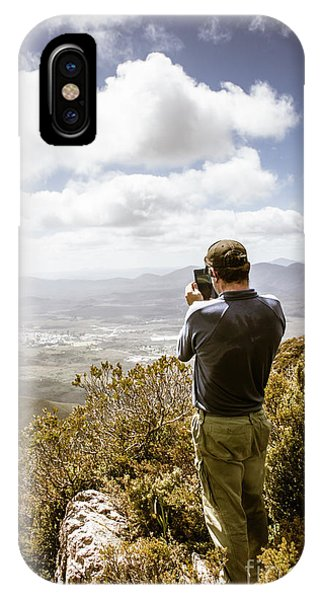 Discovery iPhone Case - Male Tourist Taking Photo On Mountain Top by Jorgo Photography - Wall Art Gallery