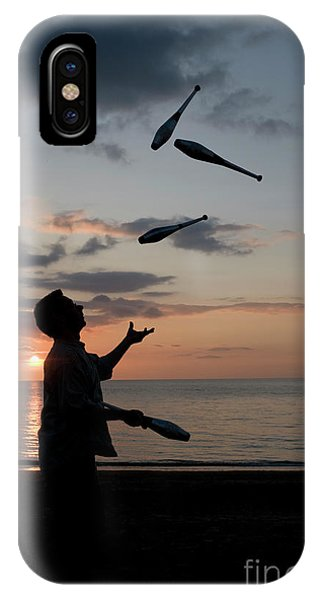 Man Juggling With Four Clubs At Sunset IPhone Case