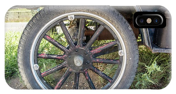 Old Truck Tire In Rural Rocky Mountain Town IPhone Case
